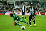 Allan Saint-Maximin (#10) of Newcastle United skips over the challenge from Martin Montoya (#22) of Brighton & Hove Albion during the Premier League match between Newcastle United and Brighton and Hove Albion at St. James's Park, Newcastle, England on 21 September 2019.