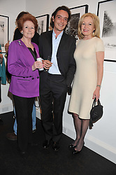 Left to right, LADY ELIZABETH ANSON, her nephew the 6th EARL OF LICHFIELD and LADY ANNUNCIATA ASQUITH at a private view of the late Patrick Lichfield: Nudes at The Little Black gallery, 13A Park Walk, London SW10 on 26th April 2012.