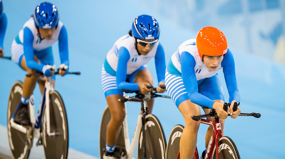 Nicolle Bruderer of Guatemala leads her team as they compete in the women's team pursuit qualification on the fist day of track cycling at the 2015 Pan American Games in Toronto, Canada, July 16,  2015.  AFP PHOTO/GEOFF ROBINS