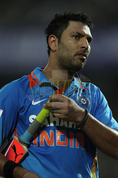 Yuvraj Singh of India departs during the 1st Airtel ODI Match between India and England held at the SAURASHTRA CRICKET ASSOCIATION STADIUM, RAJKOT, India on the 11th January 2013..Photo by Ron Gaunt/BCCI/SPORTZPICS ..Use of this image is subject to the terms and conditions as outlined by the BCCI. These terms can be found by following this link:..http://www.sportzpics.co.za/image/I0000SoRagM2cIEc