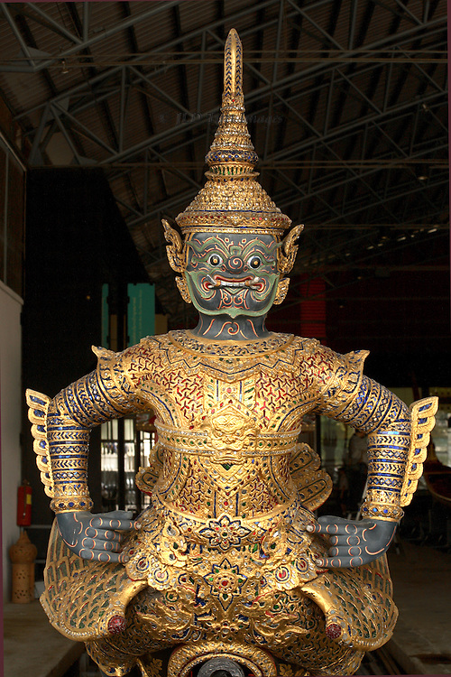 Jewel-encrusted gold mythical protective  figure on the prow of the Aaura Vayuphak royal barge in the Royal Barge Museum, Bangkok, Thailand.