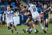 Gavin Bennion (8) of Swinton Lions tackles James Harrison (10) of Featherstone Rovers during the Betfred Championship match between Featherstone Rovers and Halifax RLFC at the Big Fellas Stadium, Featherstone, United Kingdom on 9 February 2020.