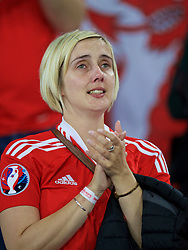 LILLE, FRANCE - Friday, July 1, 2016: A Wales supporter in tears as she celebrates after a 3-1 victory over Belgium and reaching the Semi-Final during the UEFA Euro 2016 Championship Quarter-Final match at the Stade Pierre Mauroy. Angela Roberts. (Pic by David Rawcliffe/Propaganda)