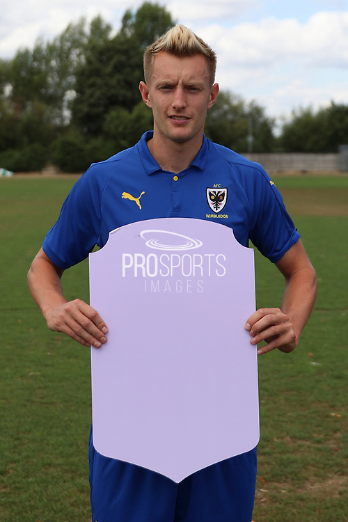 AFC Wimbledon striker Joe Pigott (39) holding Fifa sign during the AFC Wimbledon 2018/19 official photocall at the Kings Sports Ground, New Malden, United Kingdom on 31 July 2018. Picture by Matthew Redman.