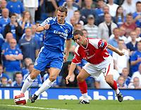 Photo: Ed Godden.<br />Chelsea v Charlton Athletic. The Barclays Premiership. 09/09/2006. Chelsea's Andriy Shevchenko (L) makes his way past Luke Young.