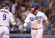 June 12, 2018 - Los Angeles, CA, U.S. - LOS ANGELES, CA - JUNE 12: Los Angeles Dodgers catcher Yasmani Grandal (9) congratulates Los Angeles Dodgers third baseman Justin Turner (10) after scoring a run during the game between the Texas Rangers and the Los Angeles Dodgers on June 12, 2018, at Dodger Stadium in Los Angeles, CA. (Photo by David Dennis/Icon Sportswire) (Credit Image: © David Dennis/Icon SMI via ZUMA Press)