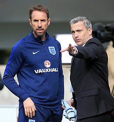 England manager Gareth Southgate (left) and FA head of communications Greg Demetriou during a training session for the media day at St George's Park, Burton upon Trent. Picture date: Monday October 2, 2017. See PA story SOCCER England. Photo credit should read: Nick Potts/PA Wire. RESTRICTIONS: Use subject to FA restrictions. Editorial use only. Commercial use only with prior written consent of the FA. No editing except cropping.