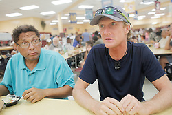 September 9, 2017 - City, Florida, U.S. - OCTAVIO JONES   |   Times .Todd Mitchell, 52, left, of Tampa and ReneÂ« Frederickson of Norway talk her dinner while taking shelter at Middleton High School in Tampa on Saturday, September 9, 2017. Over 900 people are taking shelter from Hurricane Irma at Middleton High School. (Credit Image: © Octavio Jones/Tampa Bay Times via ZUMA Wire)