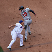 Pitcher Bartolo Colon, New York Mets, tags out A.J. Pierzynski, Atlanta Brazes, during the New York Mets Vs Atlanta Braves MLB regular season baseball game at Citi Field, Queens, New York. USA. 23rd April 2015. Photo Tim Clayton