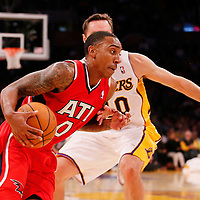 03 November 2013: Atlanta Hawks point guard Jeff Teague (0) drives past Los Angeles Lakers point guard Steve Nash (10) during the Los Angeles Lakers 105-103 victory over the Atlanta Hawks at the Staples Center, Los Angeles, California, USA.
