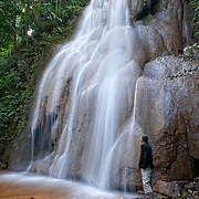 Hiker at Mae Sawan Noi Waterfall. located in Mae Hoh (or Mae Haw), Amphur Mae Sariang, Mae Hong Son, Thailand. This 5 tier waterfall is located in the hills close to Mae Sariang.