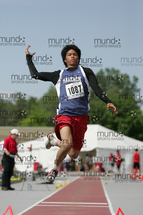 (London, Ontario}---05 June 2010) Grant Cheng of Markham - Markham    competes in the senior boys long jump at the 2010 OFSAA Ontario High School Track and Field Championships in London, Ontario,  June 05, 2010. Photograph copyright Laura Barclay / Mundo Sport Images, 2010.