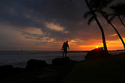 landscape photography, silhouette of photographer against a backdrop of a Hawaiian sunset.