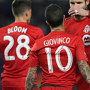 NEW YORK, NEW YORK - November 06:  Sebastian Giovinco #10 of Toronto FC celebrates hit hat-trick while congratulated by team mates during the NYCFC Vs Toronto FC MLS playoff game at Yankee Stadium on November 06, 2016 in New York City. (Photo by Tim Clayton/Corbis via Getty Images)