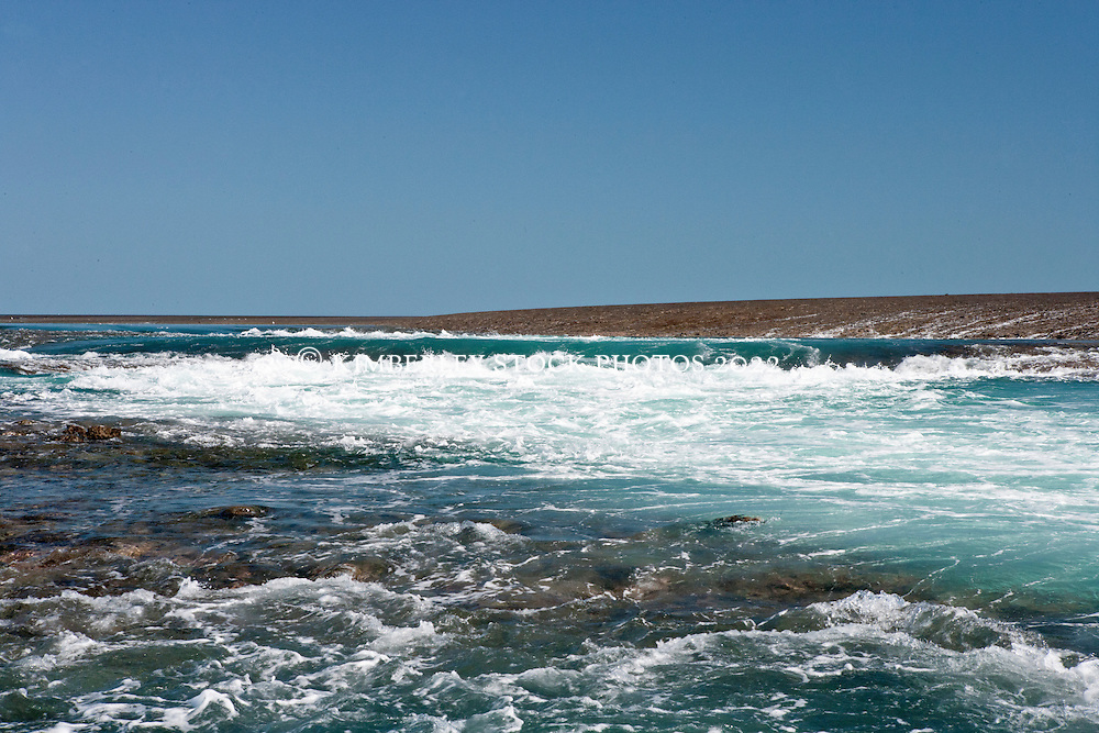 Water cascades off Montgomery Reef in Collier Bay.