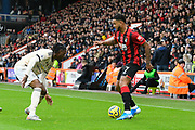 Joshua King (7) of AFC Bournemouth looks for a way past Aaron Wan-Bissaka (29) of Manchester United during the Premier League match between Bournemouth and Manchester United at the Vitality Stadium, Bournemouth, England on 2 November 2019.