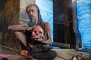 A Alghori Sadhu in the almshouse.<br />