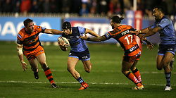 St Helens Jonny Lomax (second left) evades a tackle from Castleford Tigers Alex Foster (second right) during the Betfred Super League match at the Mend-A-Hose Jungle, Castleford.