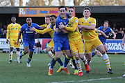 AFC Wimbledon defender Sean Kelly (22) gets fouled during the EFL Sky Bet League 1 match between AFC Wimbledon and Millwall at the Cherry Red Records Stadium, Kingston, England on 2 January 2017. Photo by Stuart Butcher.