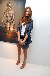 ROSIE HUNTINGTON-WHITELEY at an exhibition of paintings by artist Rene Richard at the Scream Gallery, Bruton Street, London on 3rd April 2008.<br />
