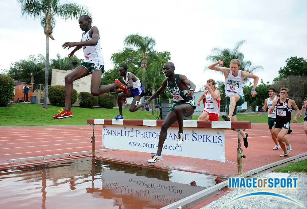 May 24, 2008; Walnut, CA, USA; Reuben Chebon-Mwei of Adams State (2), Daniel Maina of Abilene Christian (1), David Kiplagat of Alaska (10) and Jasper Peach of Humboldt State (4) negotiate the water jump in the steeplechase in the NCAA Division II Track & Field Championships at Mt. San Antonio College's Hilmer Lodge Stadium.