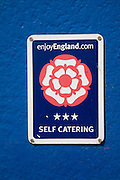 Close up of three star self catering sign produced by enjoyEngland.com as a quality assurance mark for tourist accommodation,