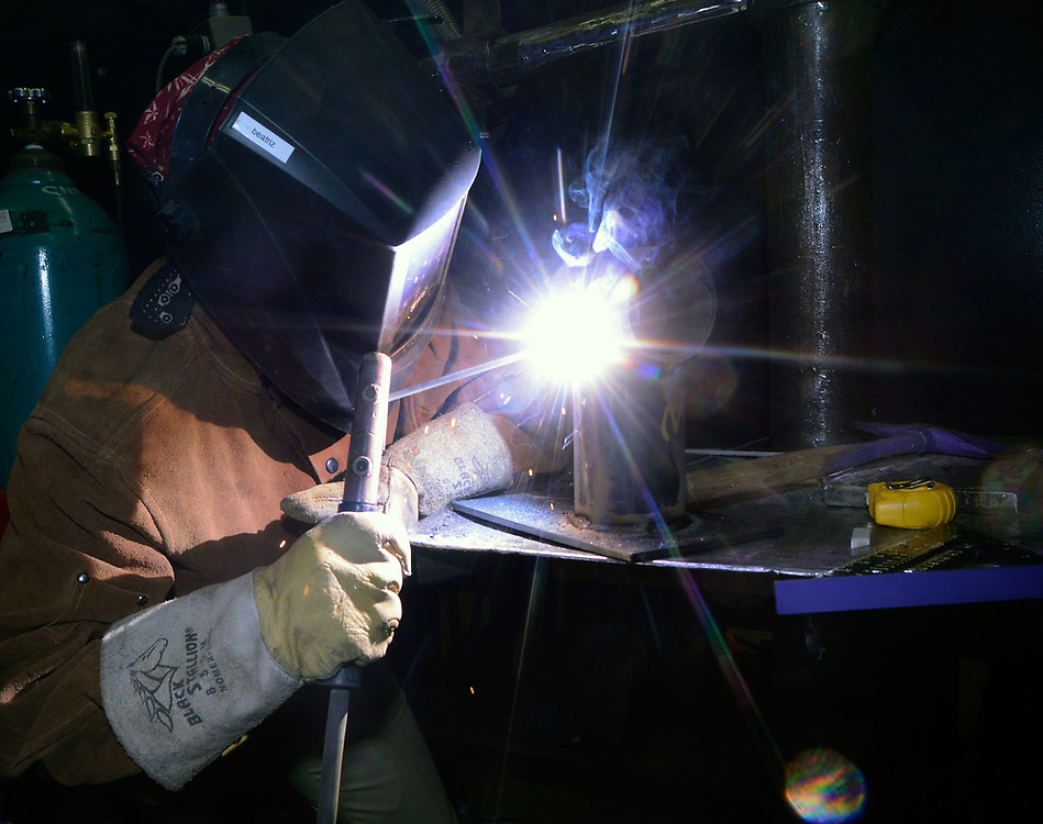jt033117h/a sec/jim thompson/   Beatriz Gonzalez from NMSU welds in the  SkillsUSA  competition on the CNM Main campus in Albuquerque, NM. Friday March 31, 2017. (Jim Thompson/Albuquerque Journal)