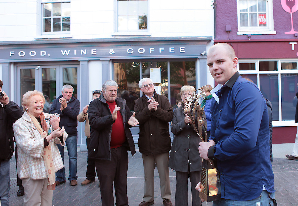 XXjob 12/05/2013 NEWS.Pictured at Clonakilty square to welcome Kilmeen Drama Group as they make their way home after their historic three in a row overall win in the All Ireland Drama Finals at Athlone over the weekend. Jack Coffey is pictured being clapped into the square by the good wishers. His Father was the original director of the production who tragically passed away 6 weeks ago..Picture: Emma Jervis..