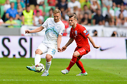 Ales Mertelj of Slovenia and Jack Wilshere of England during the EURO 2016 Qualifier Group E match between Slovenia and England at SRC Stozice on June 14, 2015 in Ljubljana, Slovenia. Photo by Mario Horvat / Sportida