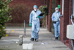 © Licensed to London News Pictures. 01/01/2018. London, UK. Police forensics at the scene where a man was stabbed to death Near Old Street in east London early on New Year's Day. Four people were stabbed to death in a short period over New Year. Photo credit: Ben Cawthra/LNP