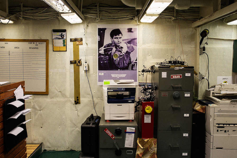 A poster of &quot;Maverick&quot; from the movie Top Gun inside the ready room of  VFA-25, a strike fighter squadron that is known in the Navy as &ldquo;Fist of the Fleet&rdquo;. The crew added a patch from their squadron on Tom Cruise's uniform.<br /> <br /> Aboard the USS Harry S. Truman operating in the Persian Gulf. February 25, 2016.<br /> <br /> Matt Lutton / Boreal Collective for Mashable