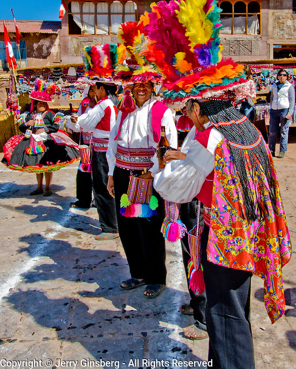 Flamboyant costumes are the ticket at the Festival of St.James / Fiesta de San Diego on the island of Taquile in Lake Titicaca, Peru.