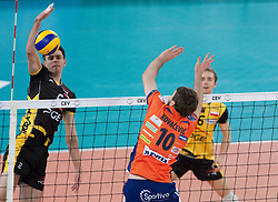 Wytze Kooistra, Pawel Woicki, Miguel Angel Falasca of Belchatow vs Uros Kovacevic of ACH during volleyball match between ACH Volley LJUBLJANA and  PGE Skra Belchatow (POL) of 2012 CEV Volleyball Champions League, Men, League Round in Pool F, 4th Leg, on December 20, 2011, in Arena Stozice, Ljubljana, Slovenia. (Photo By Grega Valancic / Sportida.com)