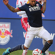 Jermaine Jones, New England Revolution, and Thierry Henry, New York Red Bulls, challenge for the ball during the New York Red Bulls Vs New England Revolution, MLS Eastern Conference Final, first leg at Red Bull Arena, Harrison, New Jersey. USA. 23rd November 2014. Photo Tim Clayton