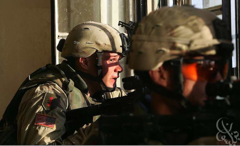 U.S. Army soldiers from the 1st Infantry Division's 2nd Battalion-2nd Regiment engage enemy fighters in heavy combat November 09, 2004 in the Iraqi insurgent stronghold of Fallujah.