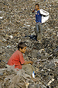 """Divers at La Mosca trash dump...176 million children.  That's more than ten percent of all the children in the world.  176 million children between the ages of five and 17 work daily in conditions that the International Labor Organization (ILO) reports are """"likely to harm their health, safety, or moral development""""."""