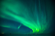 Aurora Borealis spectacular view of the Northern Lights in the sky over Hotel Ranga tourist resort at Hella in South Iceland