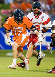 Virginia midfielder Mike Thompson (17) makes a scoop of a loose ball in front of Maryland midfielder Dan Groot (2).  The #3 ranked Virginia Cavaliers defeated the #8 ranked Maryland Terrapins 11-8 in the semi finals of the Men's 2008 Atlantic Coast Conference tournament at the University of Virginia's Klockner Stadium in Charlottesville, VA on April 25, 2008.