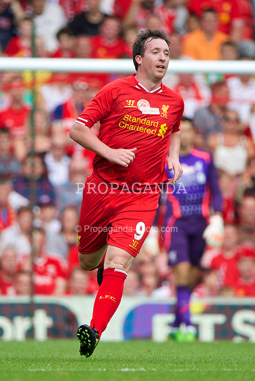 LIVERPOOL, ENGLAND - Saturday, August 3, 2013: Liverpool's Robbie Fowler in action against Olympiakos CFP during a preseason friendly match at Anfield. (Pic by David Rawcliffe/Propaganda)