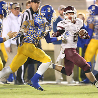 Lauren Wood   Buy at photos.djournal.com<br /> Kossuth's Hunter Brooks outruns Booneville's Jarius Crump during Friday night's game at Booneville.
