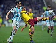Mark Hudson of Huddersfield Town and Rouwen Hennings of Burnley fight for the ball during the Sky Bet Championship match at the John Smiths Stadium, Huddersfield<br /> Picture by Graham Crowther/Focus Images Ltd +44 7763 140036<br /> 12/03/2016