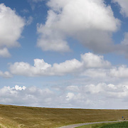 Nederland Zaamslag gemeente Terneuzen  19 juni 2010 20100619       ..Serie landschappen provincie Zeeland. Zeeuws-Vlaanderen, polderlandschap landschap dijk  westerschelde  en binnendijksgebied. Illustratief beeld vervoer, waterveiligheid, infrastructuur. , sprankelende, stijging zeespiegel, stil, stilleven, stilte, stock, stockbeeld, streek, sunny, sustainable, terrein, typerend, typical dutch landscape, typisch hollands, typisch hollands landschap, typische, uitgestrektheid, uitzicht, uniek, unieke, veiligheid, vergezicht, vergezichten, verte, vrij, vrijheid weer, waaien, water level, waterbeheer, Waterbeheerplan, waterhuishouding, waterkering, Waterkeringen, waterkeringen, waterlevel, watermanagement, waterniveau, waterpeil, waterplan, waterproblematiek, waterstaatkundige, waterstand, watersysteem, waterveiligheid, waterveiligheid en gebiedsontwikkeling, waterwerken, weersomstandigheden, weg, wegen, wegtransport, wegverkeer, wegvervoer, wei, weide, weidegang, weiland, weiland. Landscape, wijdheid, wijds, wijdsheid, wind, wit, witte, wolk, wolken, wolkenpartij, zeeland, zeeuws vlaanderen, zeeuws-vlaanderen, zeewering, zo vrij als een vogel, zonnig, zonnige dag, zware, zwitserleven gevoel ..Foto: David Rozing