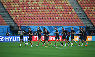 The England squad warm up during the England open training session at Arena da Amazonia, Manaus, Brazil. <br /> Picture by Andrew Tobin/Focus Images Ltd +44 7710 761829<br /> 13/06/2014