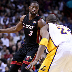 March 10, 2011; Miami, FL, USA; Miami Heat shooting guard Dwyane Wade (3) is guarded by Los Angeles Lakers shooting guard Kobe Bryant (24) during the third quarter at the American Airlines Arena. The Heat defeated the Lakers 94-88.   Mandatory Credit: Derick E. Hingle