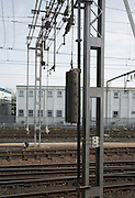 Tension weights pulling electricity power lines on railway line