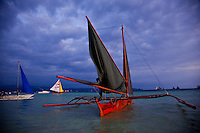 Sailboats off White Sand Beach in the late afternoon, Boracay island, Philippines.