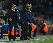 Brighton Manager, Chris Hughton and Queens Park Rangers manager Jimmy Floyd Hasselbaink during the Sky Bet Championship match between Queens Park Rangers and Brighton and Hove Albion at the Loftus Road Stadium, London, England on 15 December 2015.