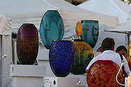Display of blown-glass vases adorns artist's booth at St. Louis Art Fair, nationally renowned for attracting high-end works of art in all media; Clayton, Missouri.