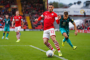 Barnsley forward Conor Chaplin (11) passes the ball during the EFL Sky Bet Championship match between Barnsley and Swansea City at Oakwell, Barnsley, England on 19 October 2019.
