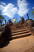 Boy running up stairs at Audience Hall in The Ancient City Polonnaruwa, Sri Lanka